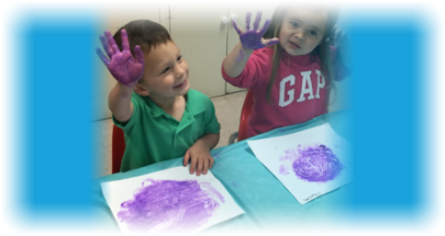 young kids with painted hands