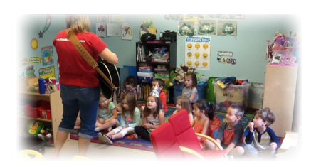 kids watching teacher plays guitar