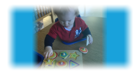 young boy playing puzzle